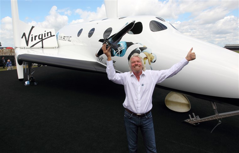 Space company Virgin Galactic's CEO Richard Branson with spacecraft